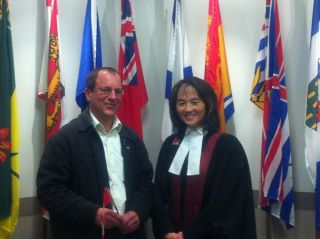 Posing after the citizenship ceremony with Judge Joan May Way
